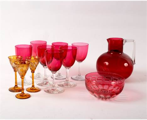A quantity of cranberry glass and three amber tinted cordial glasses CONDITION REPORT: The jug appears to be early 20th Centu