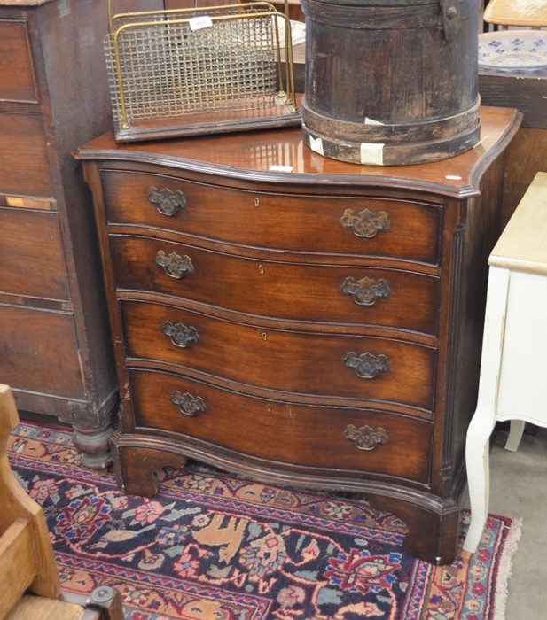 Lot 15 - A Georgian style mahogany serpentine front chest with fluted canted corners and four drawers