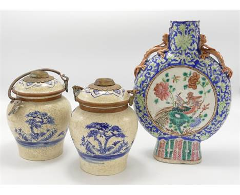 A collection of Chinese porcelain crackle glazed vases: comprising two handled flask and pair cracked glaze jar & covers,