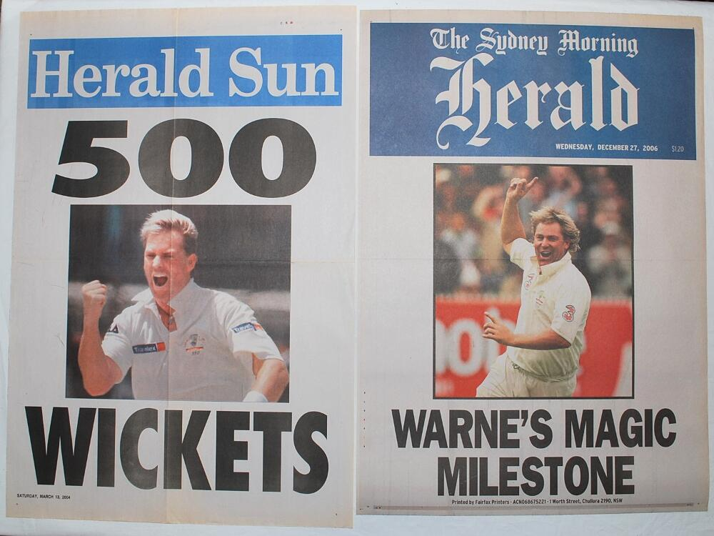 Lot 27 - Shane Warne Test wicket milestones. Two original colour newspaper posters celebrating significant