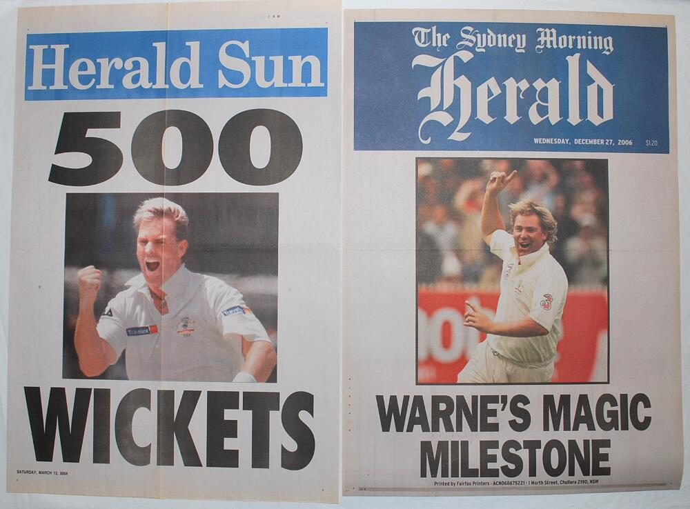Lot 28 - Shane Warne Test wicket milestones. Two original colour newspaper posters celebrating significant