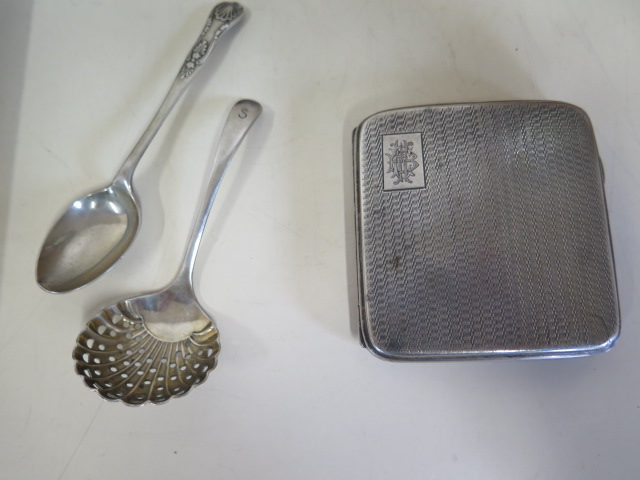 A silver cigarette case, a silver spoon and a plated sifter, silver weight approx 3.5 troy oz