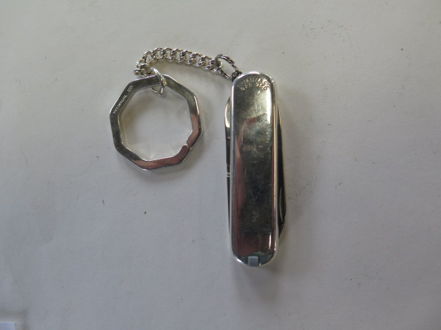 A Tiffany and Co silver and white gold penknife key ring, marked 925/750 Victorinox blade, - Image 4 of 4