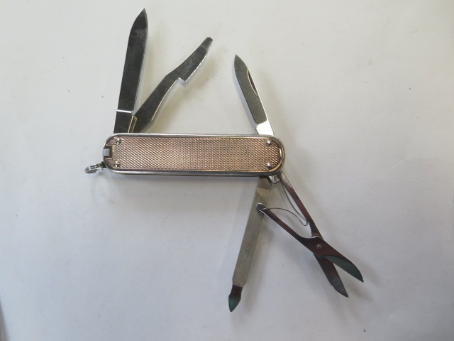 A silver Victorinox penknife, two blades, scissors and two other attachments, generally good, some - Image 3 of 3