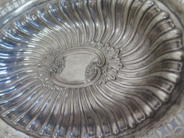 An embossed silver basket with pierced border, Birmingham 1895/96 approx 21.4 toy oz, 24cm tall with - Image 3 of 7
