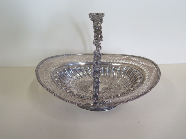 An embossed silver basket with pierced border, Birmingham 1895/96 approx 21.4 toy oz, 24cm tall with