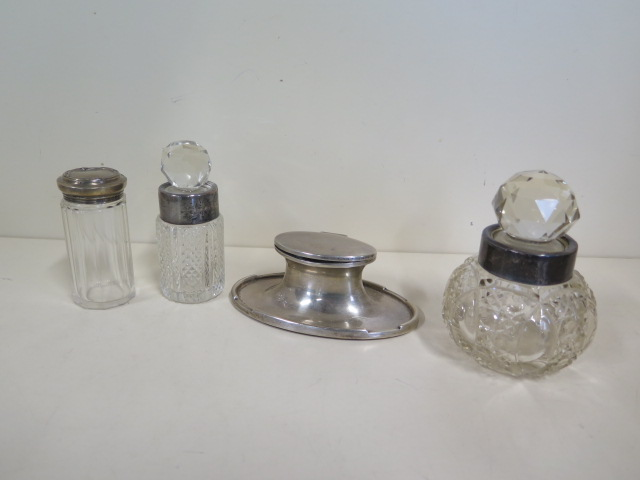 A silver Capstan inkwell, two silver rimmed bottle and a silver top bottle