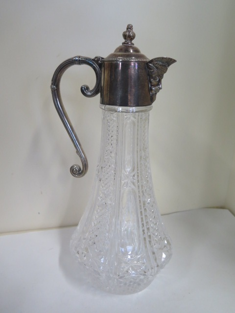 A silver plated claret jug, height 28.5cm, in good condition