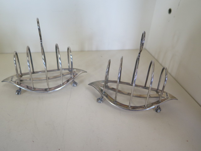 A pair of small navette shape silver toast racks, hallmarked London 1905 by William Hutton and