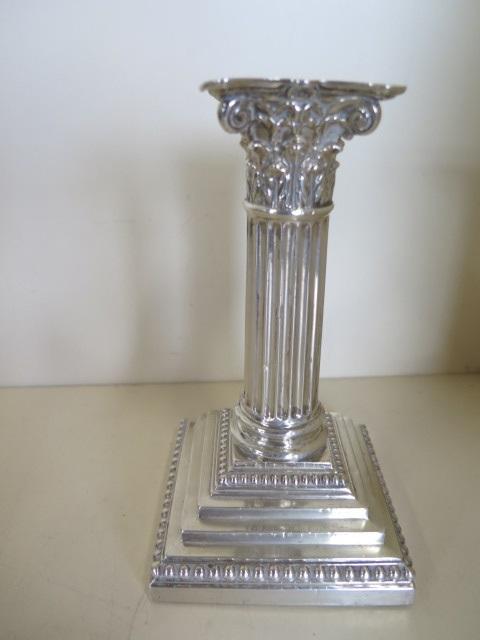 A single silver Corinthian column candlestick with filled base, hallmarked Sheffield 1891 - maker