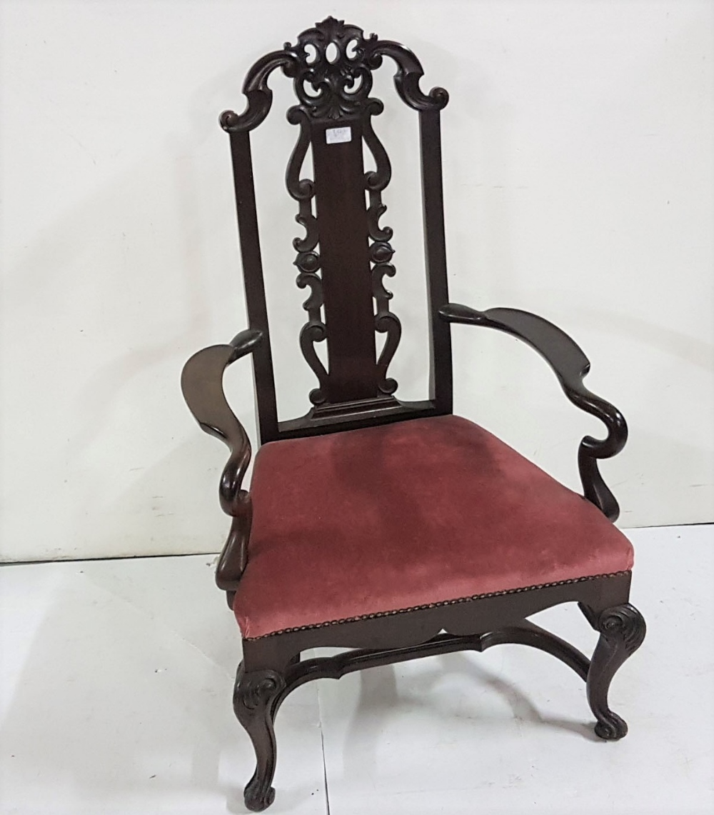 Lot 24 - Late 19th C mahogany low seated Armchair, a decorative pediment with splat back, curved arms,