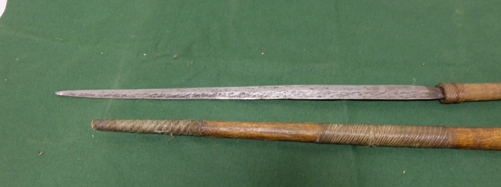 "Lot 59 - Swordstick with wooden handle, bound with copper wire and a similar wooden scabbard, 36"" long"