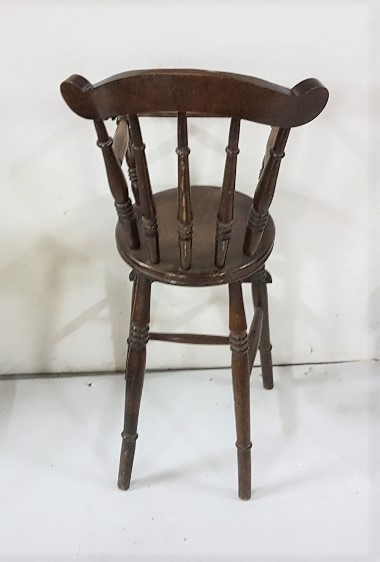 """Lot 37 - Child's Elm High Chair with spindle back, with guard rail and footrest, 17""""w x 36""""h"""