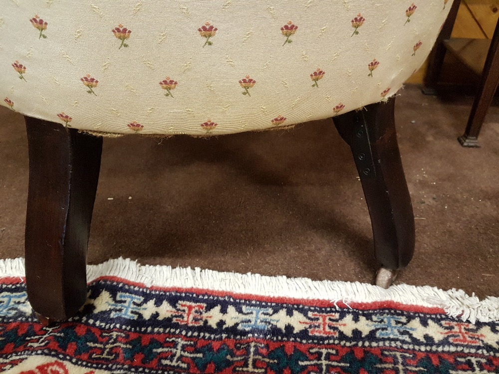 Lot 2 - Victorian mahogany framed armchair with a lovely dart boarded top, turned front legs, cup casters,