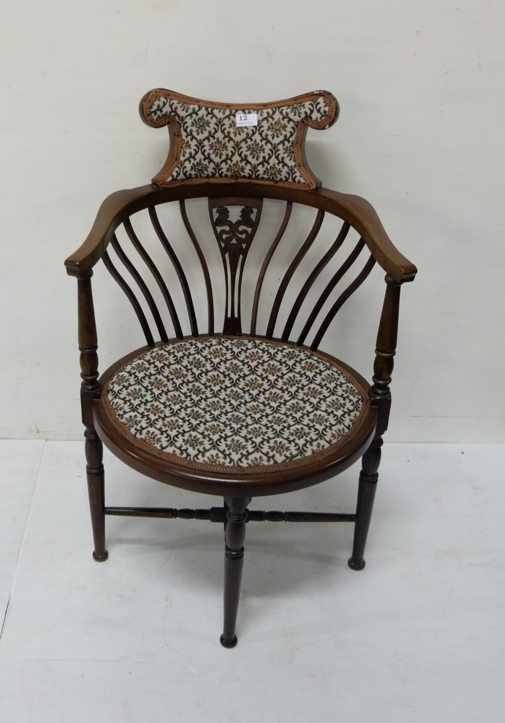 Lot 12 - Mahogany Bow-shaped Armchair, with padded back and seat, spindle shaped legs