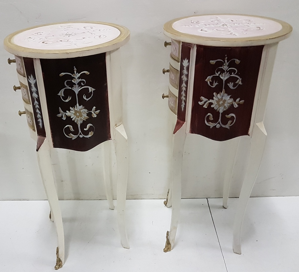 Lot 38 - Matching Pair of narrow circular Cabinets, painted white and with floral décor, each 35cm dia x 76cm