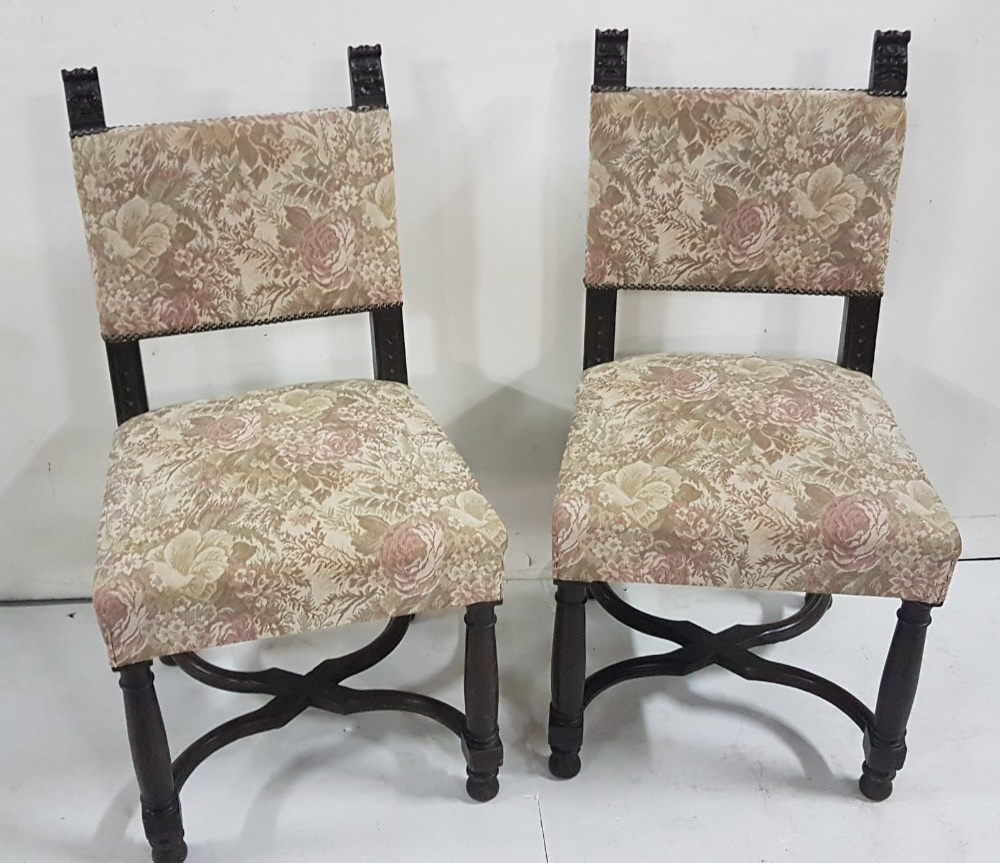 Lot 14 - Pair of early 20thC Oak Side Chairs, with padded backs and seats, with Bacchus design finials,