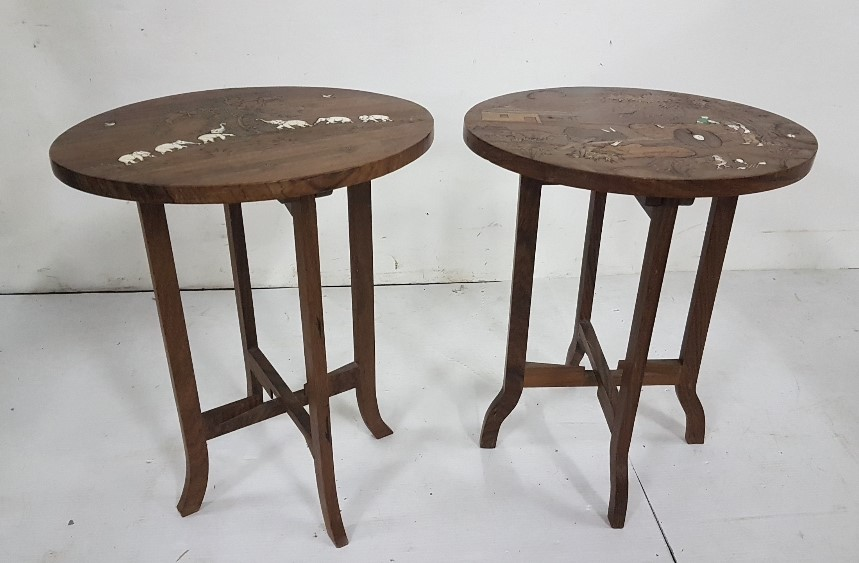 "Lot 22 - Similar Pair of low Occasional Tables, Indian rosewood, with elephant etc patterns, each 15"" dia x"