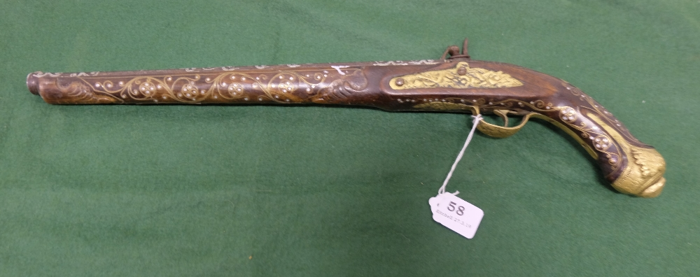 "Lot 58 - Indian Pistol with rosewood and brass inlaid muzzle, brass mounted butt, 23""long"