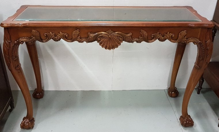 """Lot 45 - Mahogany Console / Centre Table with decorative apron on both sides, inset with a glass top, 54""""w"""