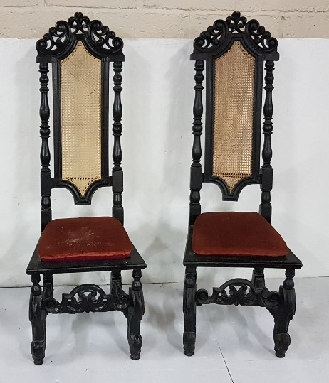 Lot 11 - Matching Pair of Jacobean Style dark oak Hall Chairs, with bergere backs, above red velvet covered