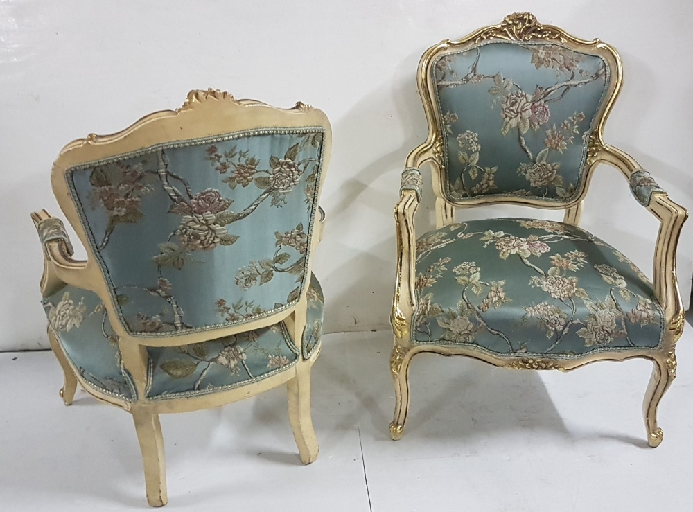 Lot 32 - Matching pair of decorative carved wood Armchairs, cream with gold highlights with floral design