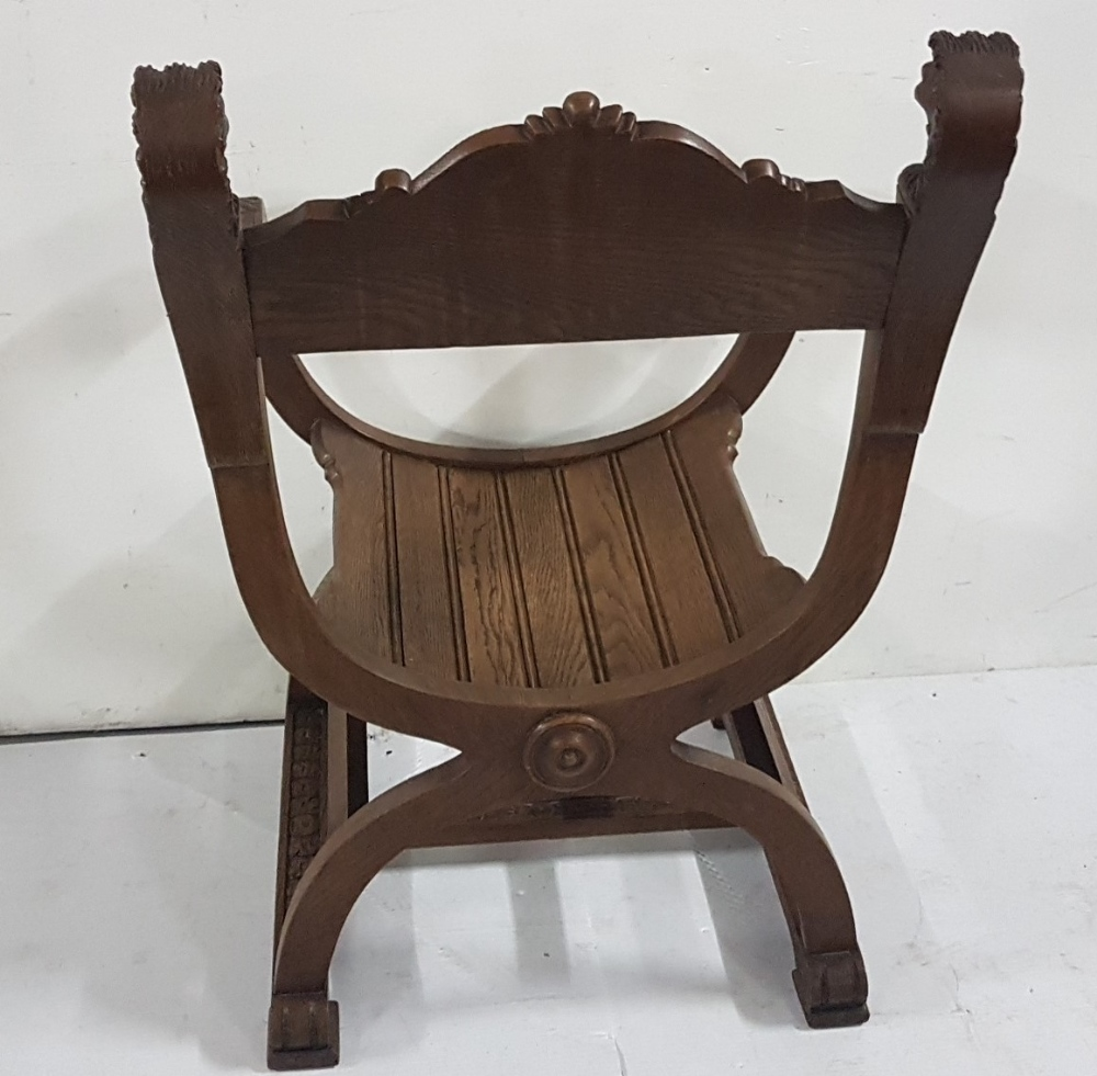 "Lot 50 - Oak ""Throne"" Armchair with lion mask finials, with carved panel on C shaped base and carved"