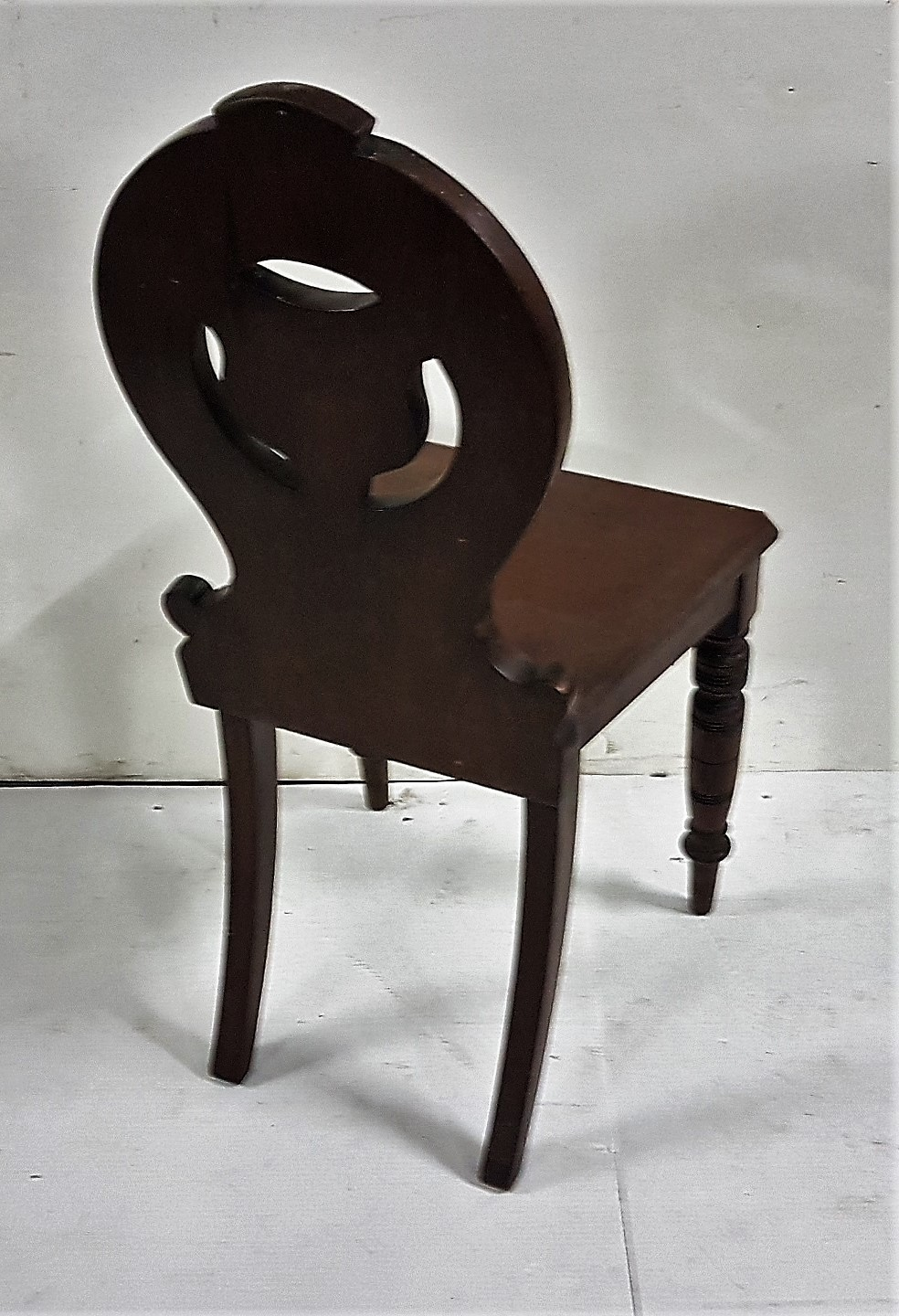 Lot 40 - Late 19th C mahogany Hall Chair, shield shaped back, with turned front legs